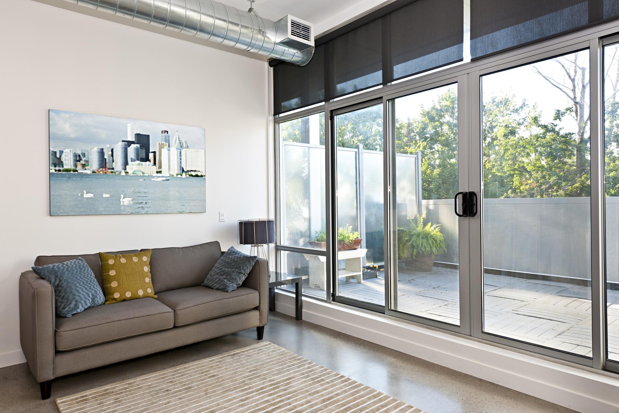 Living room with sliding glass patio door to balcony