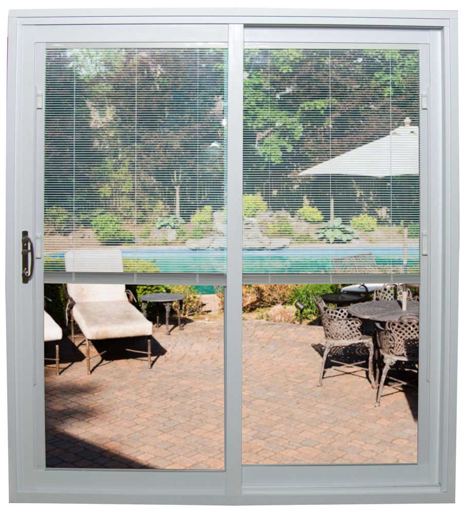 A sliding glass door with half open mini-blinds