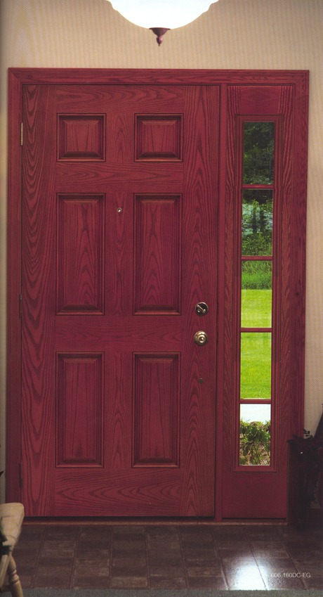 A dark red wooden door with glass sections next to it