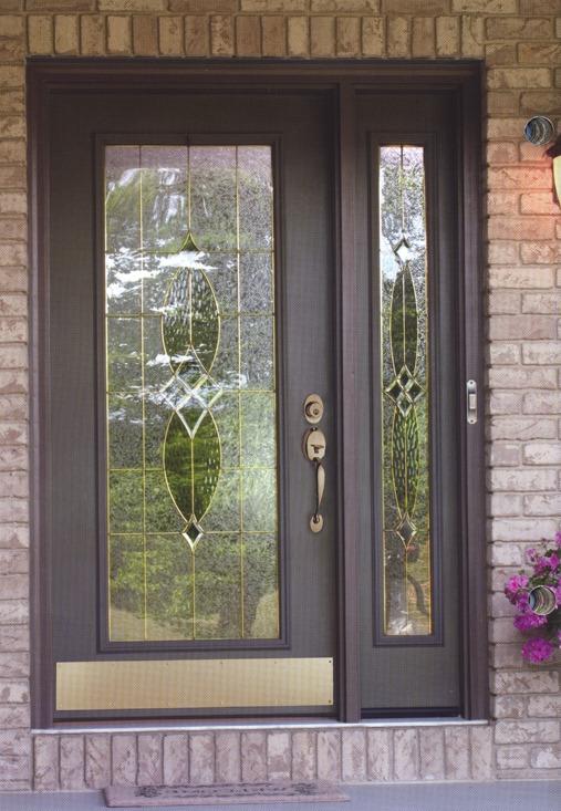 A dark wooden door with decorative glass in it