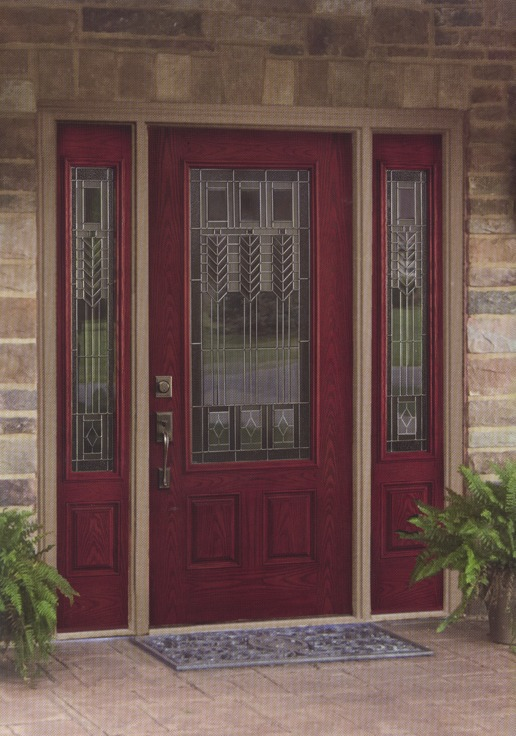 A red door with decorative etched glass inside