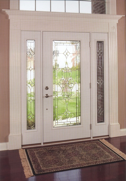 A white door with clear glass with decorative metal on it