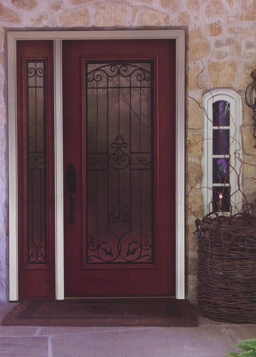 A red wooden door frame with decorative glass and metal inside
