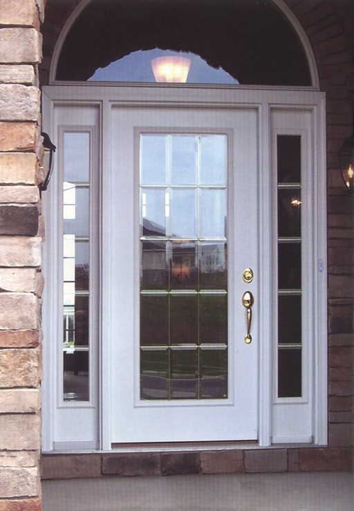 A white door frame with decorative glass inside