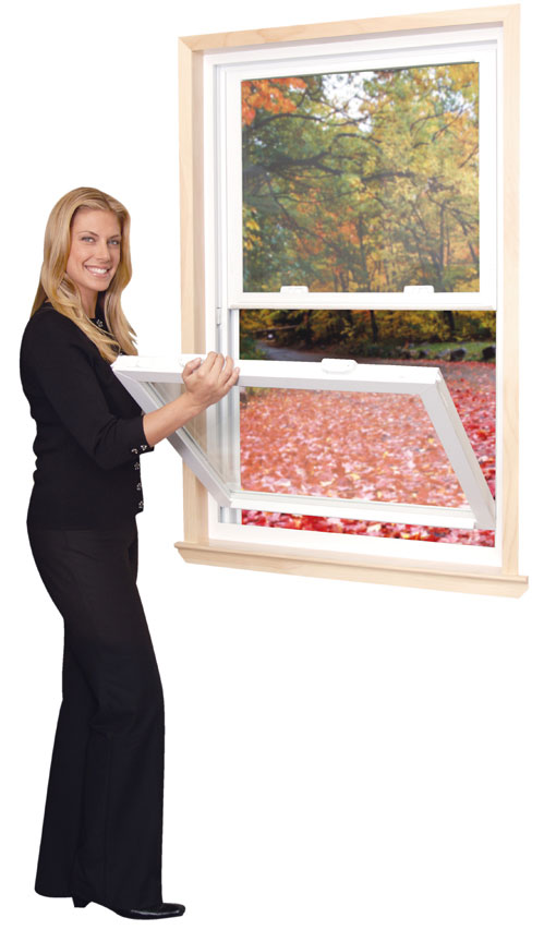 A woman opening a double hung window.