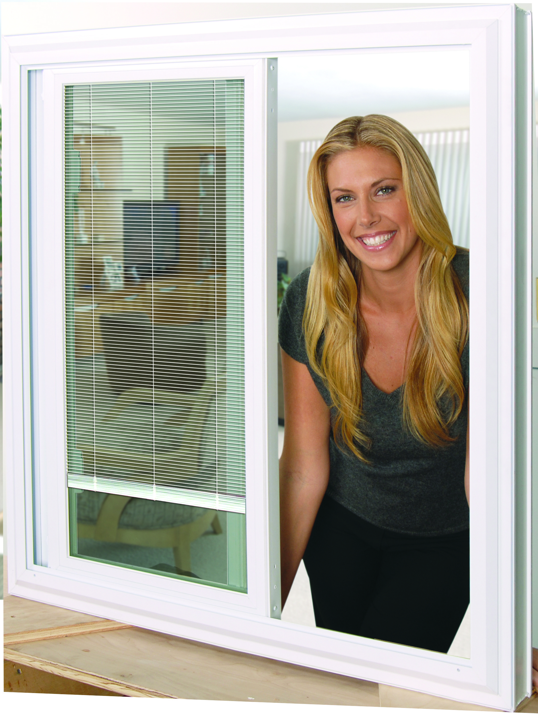 A woman leaning through an opened sliding glass window
