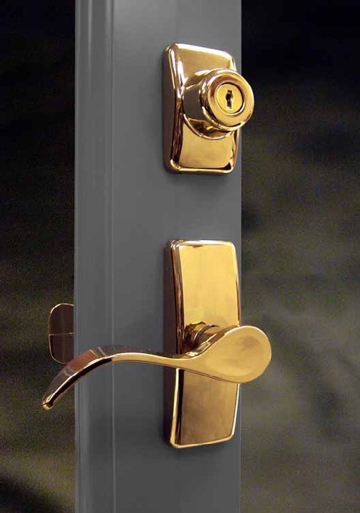 A polished metal door handle and lock.