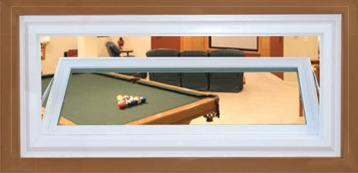 An opened awning window showing a room with a billiards table.