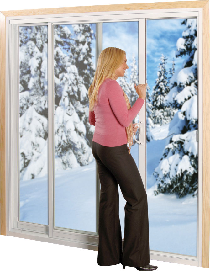 A woman closing sliding glass doors