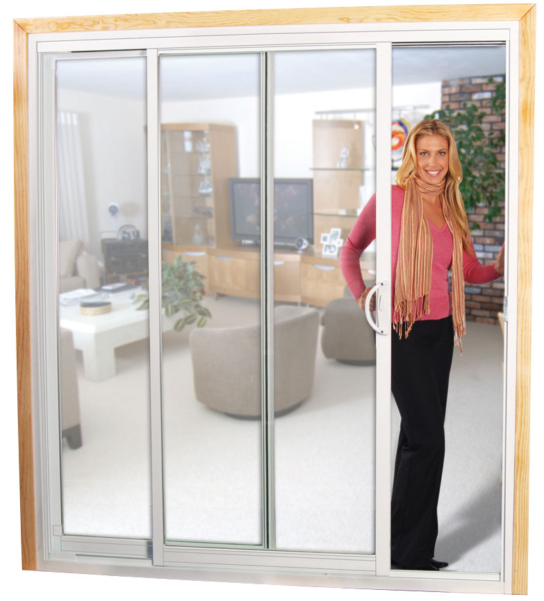 A woman standing in the doorway of sliding glass doors
