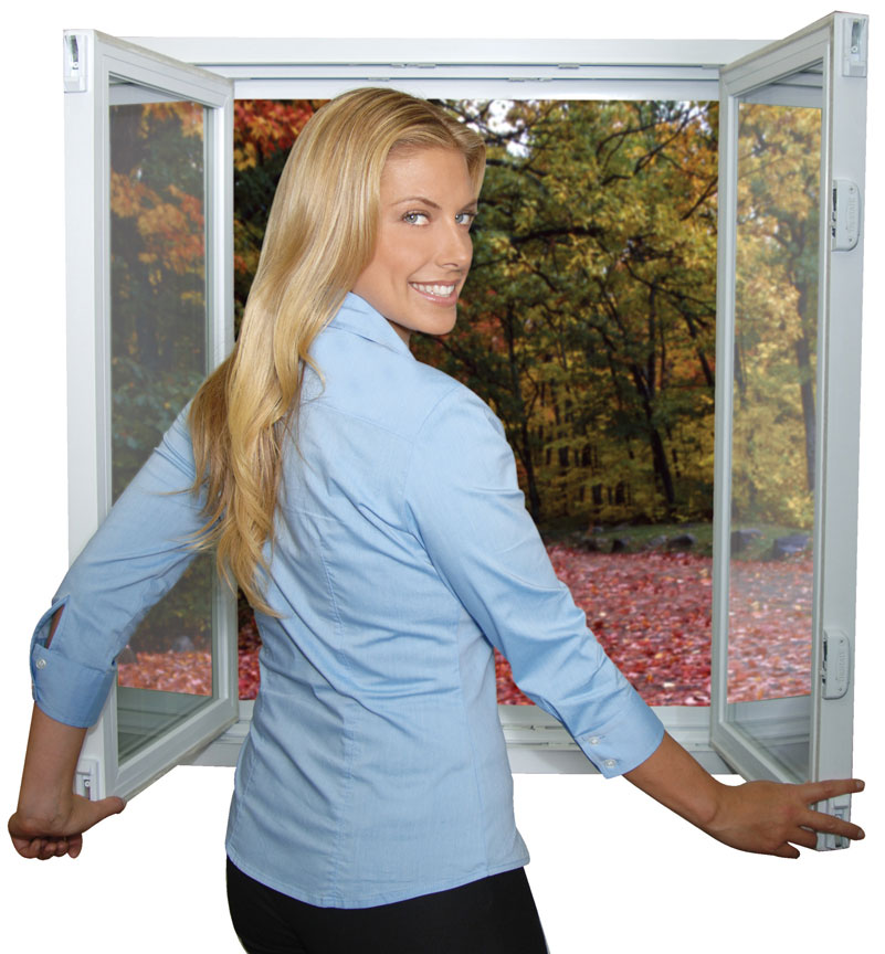 A woman looking over her shoulder in front of an open tilt-n-slide windows with fallen leaves on the ground