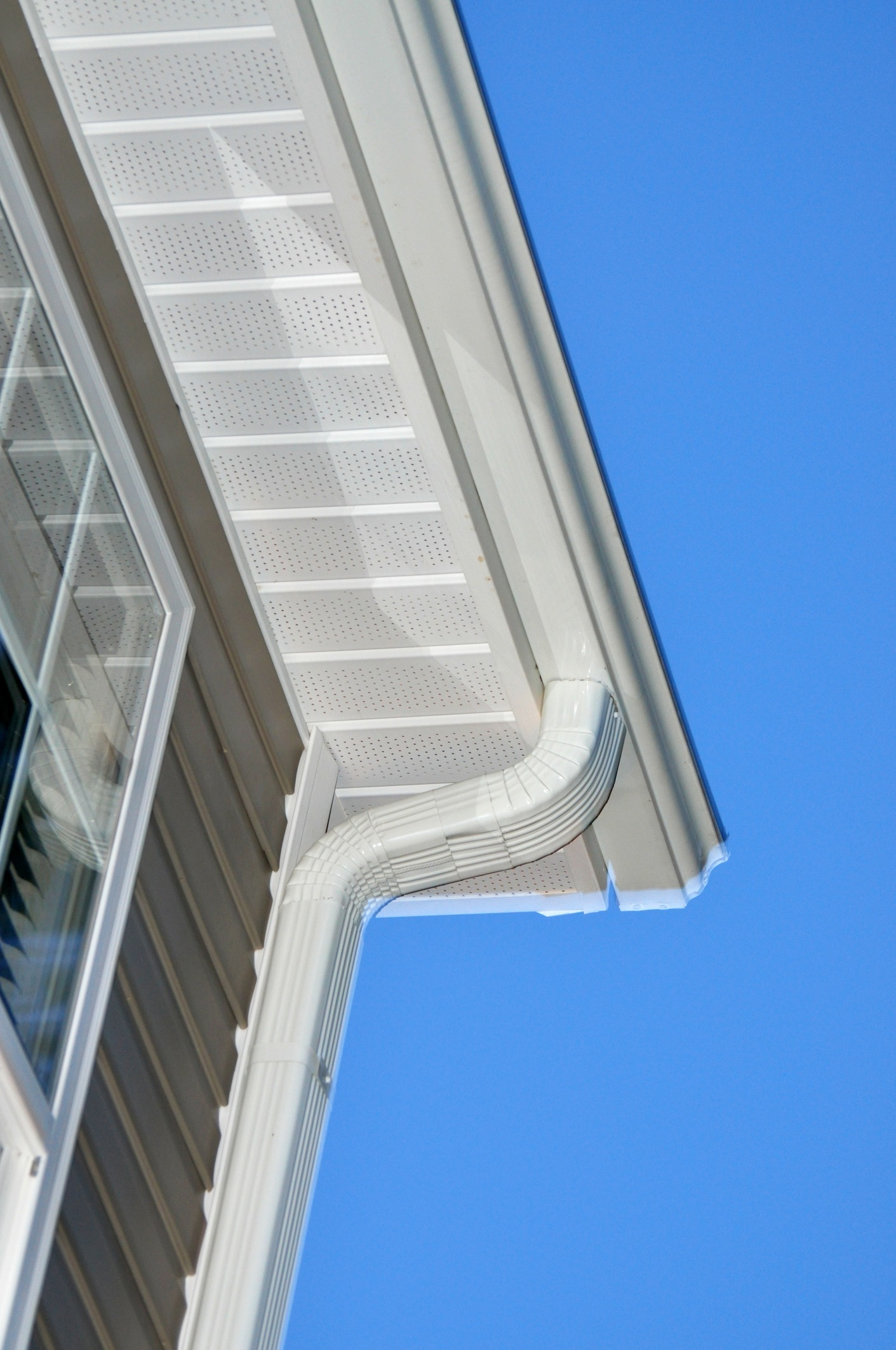 The underside of gutters on the corner of a roof