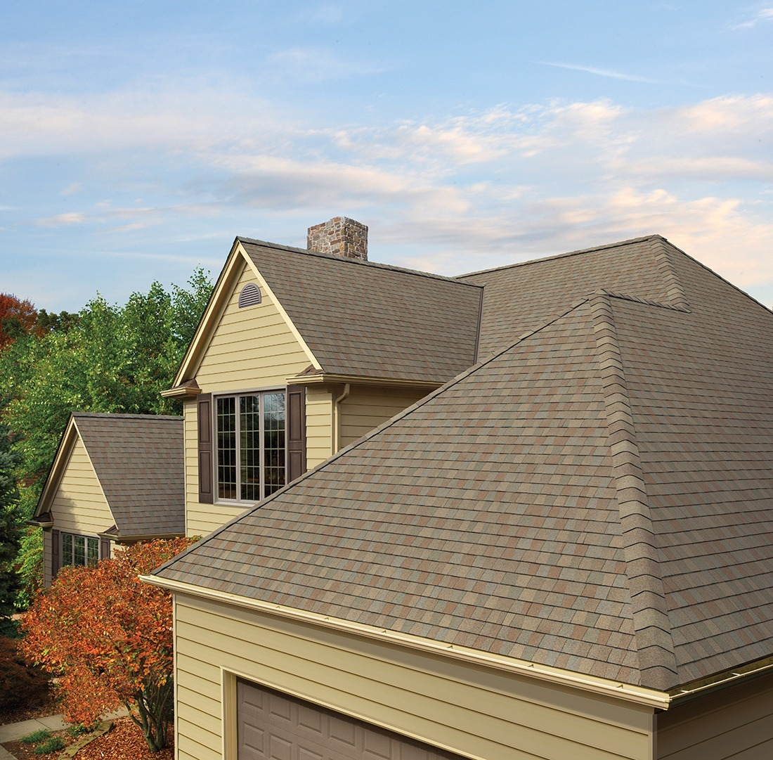 A roof with clean, flat shingles.