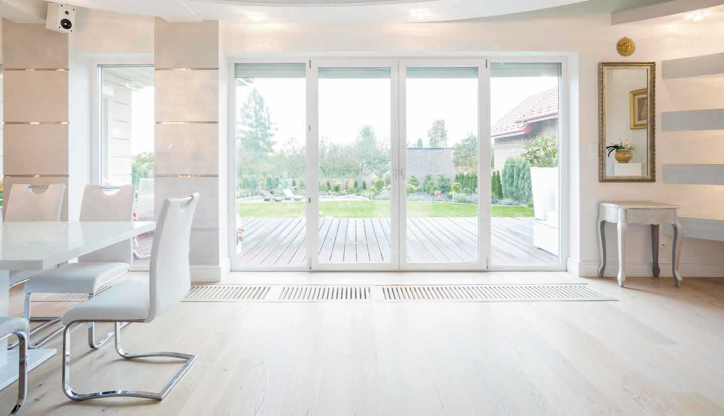 Tall sliding glass doors letting in a large amount of light.