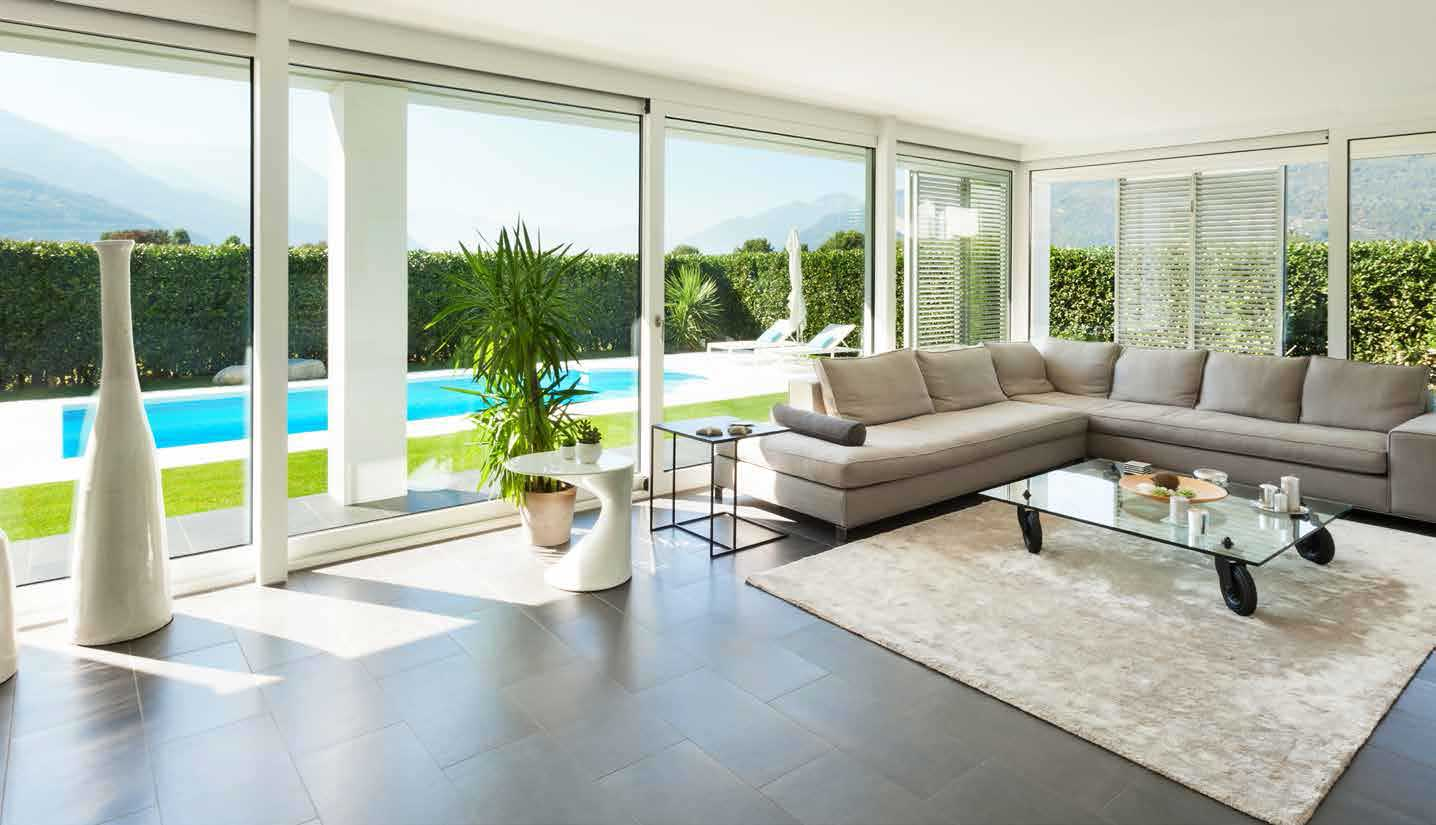 Sliding glass doors making up the entire wall, letting in vast amounts of light into the room.